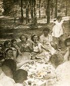 LODZ, POLAND CIRCA 1950's: Vintage photo of people enjoying a garden party