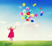 Little Girl Playing with Balloons Outdoors
