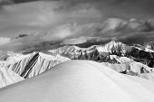 Black And White  Off-piste Snowy Slope And Cloudy Mountains