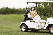 Young Woman At Golf Cart