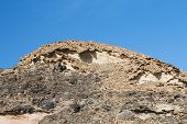 image of sedimentation  - Eroding rocks and sediments in Fuerteventura at the coast - JPG