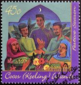 stamp printed in Cocos (Keeling) Islands shows members of Malay community