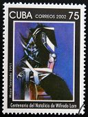 CUBA - CIRCA 2002: A stamp printed in cuba shows woman sitting by Wifredo Lam circa 2002
