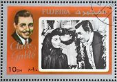 FUJEIRA - CIRCA 1972 : stamp printed in Fujeira shows actor Clark Gable circa 1972