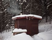 Sauna Hut In Winter Forest