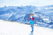 Happy Boy Playing Snow Ball Fight In The Beautiful Snow Covered Mountains