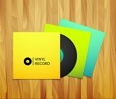 Black vintage vinyl record with blank yellow blue cyan and green cover case isolated
