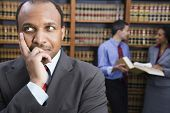 African American businessman in library