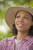 African American woman wearing straw hat