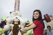 Mixed Race teenaged girl playing carnival game