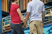 Multi-ethnic teenaged couple holding hands