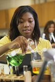 African American teenaged girl in science class