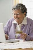 Senior Hispanic woman shopping online