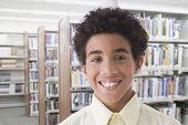 Hispanic boy in library
