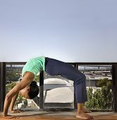 African woman practicing yoga