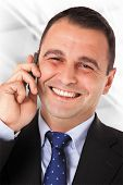 Happy businessman with suit speaking on telephone. Isolated Work Path