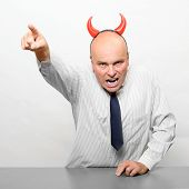 Aggressive boss downsizing his company.