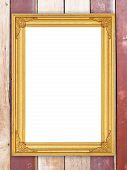 Blank Golden Frame On Wood Wall