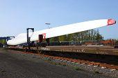 foto of wind-turbine  - A single wind turbine blade on a railway car - JPG