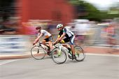Motion Blur Of Two Cyclists Racing In Georgia Cup Criterium