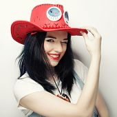 Portrait of Trendy Hipster Girl in Red Hat, studio shot