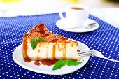 Cheese cake  in plate on polka dot tablecloth on table