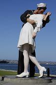 The Unconditional Surrender sculpture by Seward Johnson in the front of USS Midway in San Diego