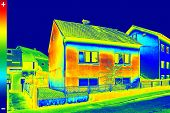 stock photo of irs  - Infrared thermovision image showing lack of thermal insulation on House - JPG