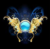 stock photo of brooch  - blue banner with gold jewelry butterfly wings on a black background - JPG
