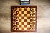 pic of chessboard  - top view of  chessboard with chess and clock - JPG