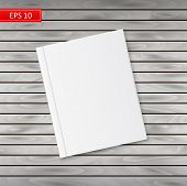 Blank Book Cover On A Wooden Background