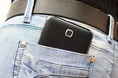 Big Mobile Phone In Woman Jeans Pocket