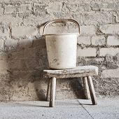 grunge wall, white bucket