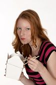 Pretty Red Head Slurping Chinese Noodles