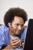 African man using electronic organizer