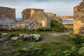 Home ruins in Ushand island coastline at the Pern point, Brittany, France