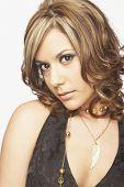 stock photo of coy  - Portrait of Hispanic woman - JPG