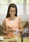 Hispanic girl setting table