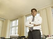 Indian businessman with arms crossed