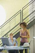 Multi-ethnic businesswomen looking at computer