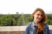 Young blonde woman posing above the city