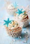 Festive Christmas cupcakes decorated with sugar snowflakes