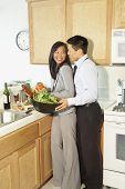 Asian couple preparing food