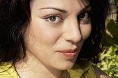 stock photo of coy  - Hispanic woman pursing lips - JPG