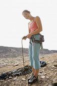 Asian woman in rock climbing gear