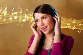 Pretty young woman listening to music, notes concept