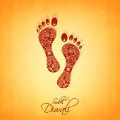 Hindu mythological Goddess Laxmi's footprint with stylish text of Diwali for Diwali celebration on orange background.