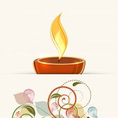 picture of diwali lamp  - Illuminated oil lit lamp for Diwali celebration for Diwali celebration on floral decorated background - JPG