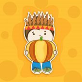 Cute little tribe boy holding big pumpkin on abstract yellow background for Happy Thanksgiving Day celebrations.