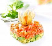 Salmon Tartar over White Background. Gourmet Food. Starter closeup
